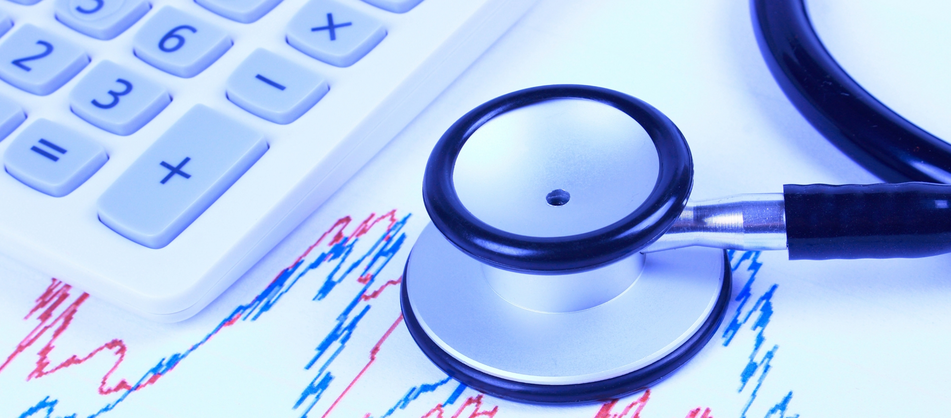 graphs-with-stethoscope-and-calculator-picture-id503072614_1
